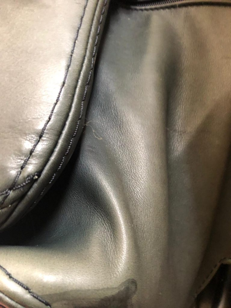 Faded Leather Recliner Swivel Chair